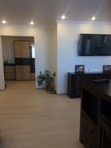 Телевизор и/или развлекательный центр в Двухкомнатная люкс
