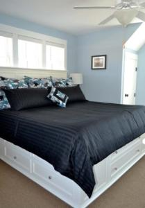 A bed or beds in a room at Impawsible Dream Three-Bedroom Home