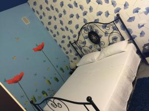 Letto o letti in una camera di B&B Dolce Sogno