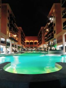 The swimming pool at or close to Jurerê Beach Village - Flat