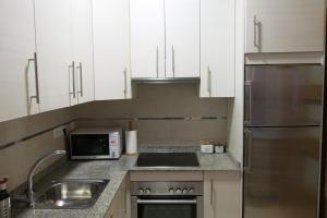 Una cocina o zona de cocina en Apartamento Duque
