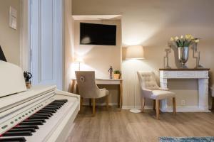 Televízia a/alebo spoločenská miestnosť v ubytovaní Luxury Apartments Kosice Centre