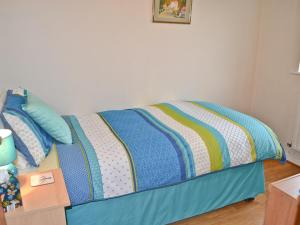 A bed or beds in a room at Woodclose Lodge