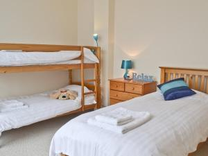 A bunk bed or bunk beds in a room at Sea View