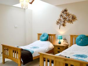 Ein Bett oder Betten in einem Zimmer der Unterkunft Cedar Lodge