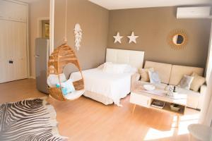 Кровать или кровати в номере BOHO Loft Marbella