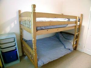 A bunk bed or bunk beds in a room at Whitehouse Cottage