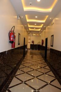 The lobby or reception area at Camillia Hotel Suites
