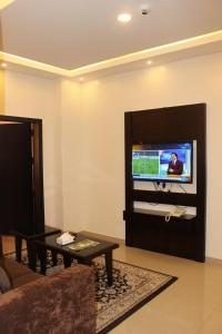 A television and/or entertainment center at Camillia Hotel Suites