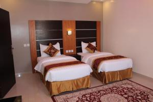A bed or beds in a room at Camillia Hotel Suites