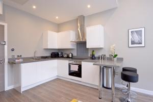 A kitchen or kitchenette at Destiny Scotland Apartments at Nelson Mandela Place