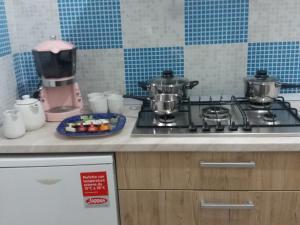 A kitchen or kitchenette at Casa rosa Andrea barbera