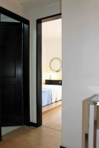 A bed or beds in a room at Cascais Terrazzo