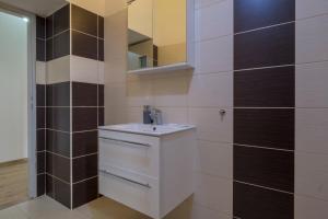 Ein Badezimmer in der Unterkunft Downtown Apartments
