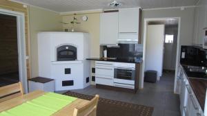 Majoituspaikan Päivärinta Cottage keittiö tai keittotila