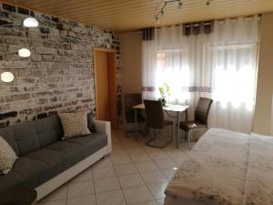 Ein Sitzbereich in der Unterkunft Apartment Mona
