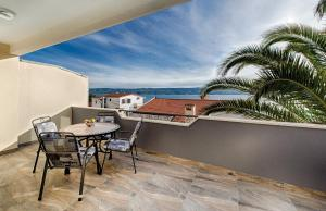 A balcony or terrace at Cezar Luxury Apartment