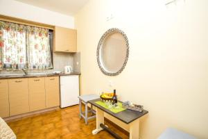 A kitchen or kitchenette at Takis Hotel Apartments