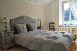 Ein Bett oder Betten in einem Zimmer der Unterkunft Relais de la Baume