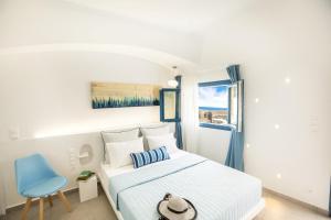 Un ou plusieurs lits dans un hébergement de l'établissement Amera Suites
