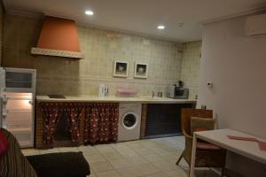 Una cocina o zona de cocina en Apartamentos Rurales Natura