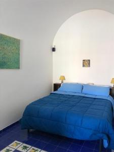 A bed or beds in a room at La Casa del Giudice