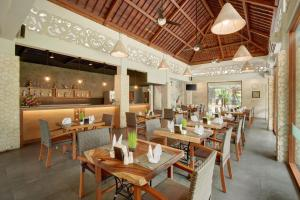 A restaurant or other place to eat at Lumbini Luxury Villas and Spa