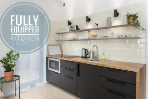 A kitchen or kitchenette at ❤❤❤ Fifty Shades of Gray studio, Ostrava city center ❤❤❤