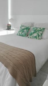 Кровать или кровати в номере Apartamento Calero