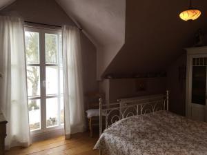 Ein Bett oder Betten in einem Zimmer der Unterkunft Landhaus Loogh