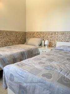 Letto o letti in una camera di A Villafontana