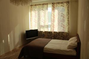 A bed or beds in a room at Happy Day
