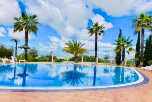 The swimming pool at or near Suite Dreams Portimão