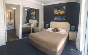 A bed or beds in a room at Santa Anne By The Sea