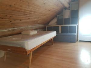 Un ou plusieurs lits dans un hébergement de l'établissement Duplex confort Marolles