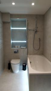 Ванная комната в Access Tower Hill