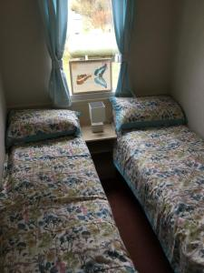 A bed or beds in a room at Fern no.11