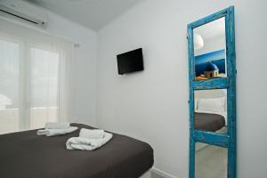 Télévision ou salle de divertissement dans l'établissement Corrado Caldera Apartments