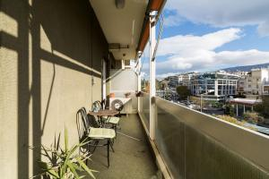 A balcony or terrace at Two-Bedroom Apartment -Kallirrois Athens