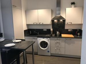 A kitchen or kitchenette at Appartement L'Ill au Sable