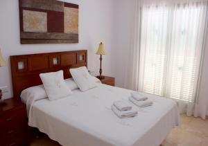 Cama o camas de una habitación en Hotel Apartamentos Manilva Sun