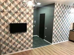 Телевизор и/или развлекательный центр в Апартаменты Бизнес