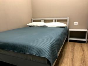 Кровать или кровати в номере Апартаменты Бизнес