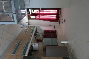 A kitchen or kitchenette at Appartamento Metaurilia