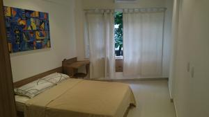 A bed or beds in a room at #111 - Domingos Beach Pad