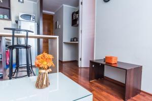 Una televisión o centro de entretenimiento en Apartamentos Riveras 4