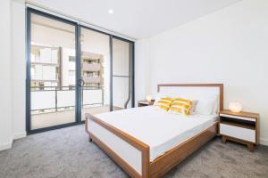 Letto o letti in una camera di Top Wonderland Serviced Apartments Airport