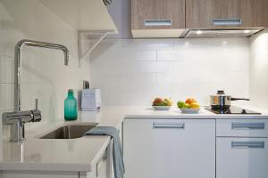 A kitchen or kitchenette at AinB Gothic-Jaume I Apartments