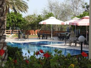 The swimming pool at or near Anna Hotel Apartments