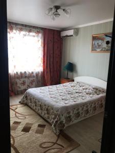 Кровать или кровати в номере Лядова 2